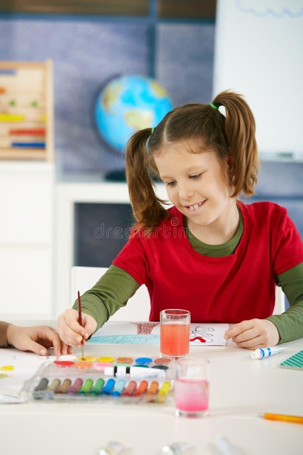 Download Schoolgirl Painting In Art Class Royalty Free Stock Image - Image: 13303336