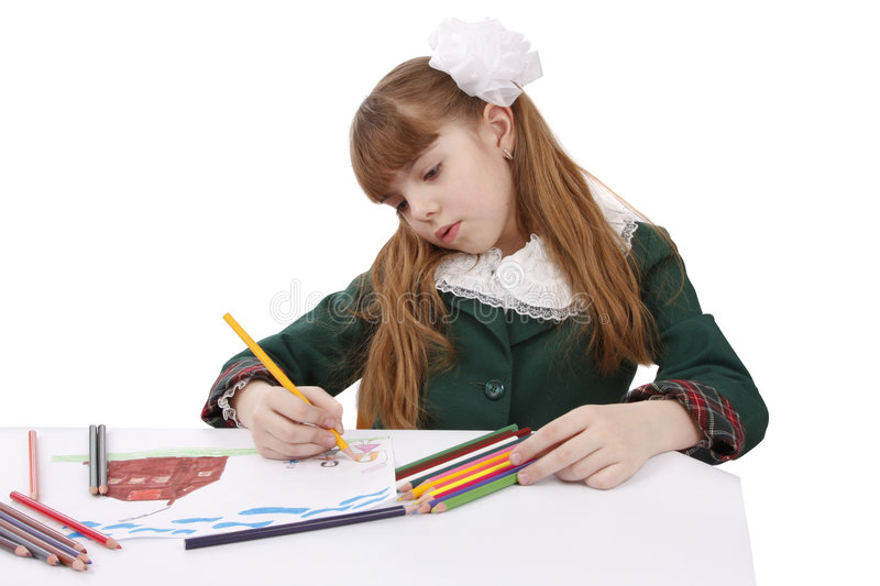 Schoolgirl is painting her family stock photography