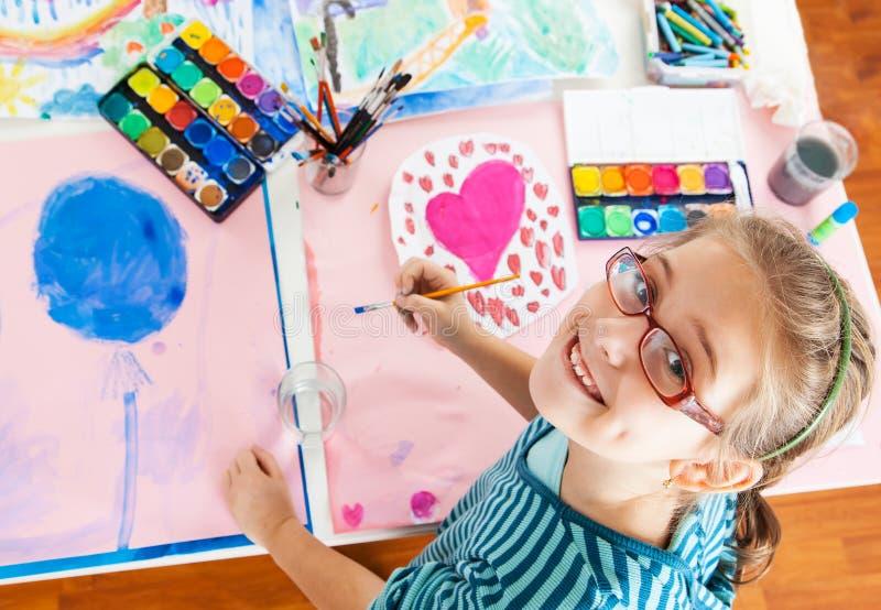 Schoolgirl painting royalty free stock photos