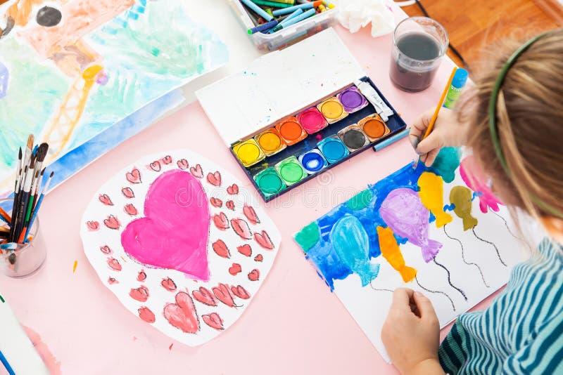 Schoolgirl painting royalty free stock image