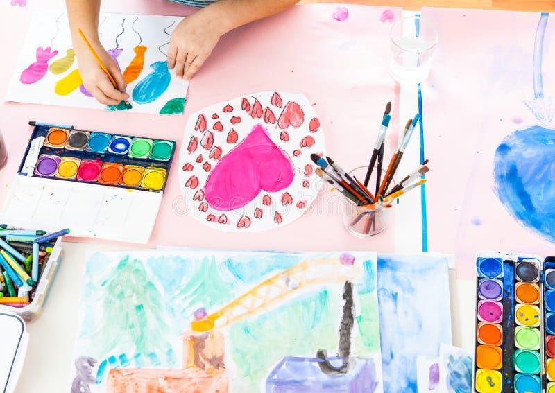 Schoolgirl painting stock photo
