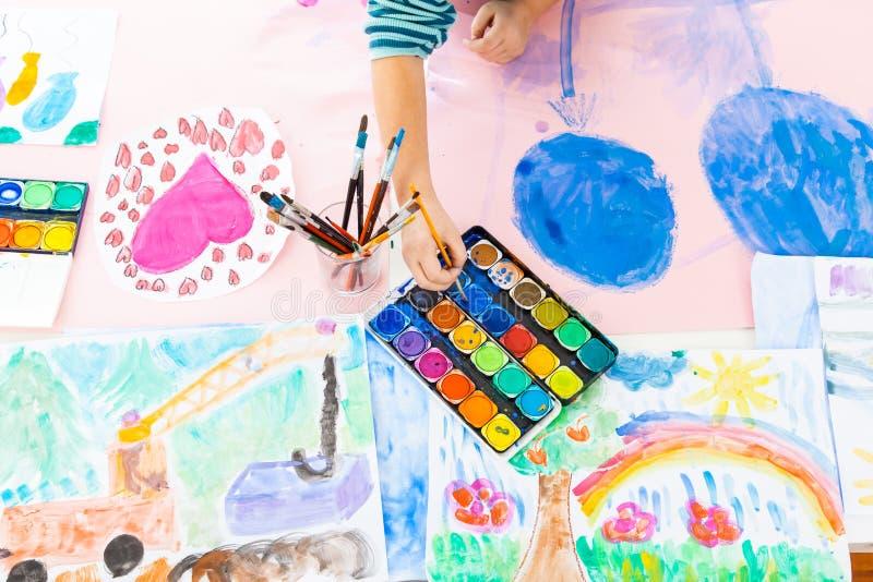Schoolgirl painting stock photos
