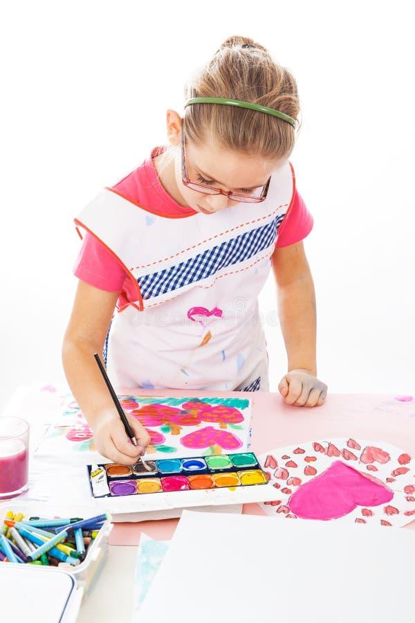 Schoolgirl painting royalty free stock photo