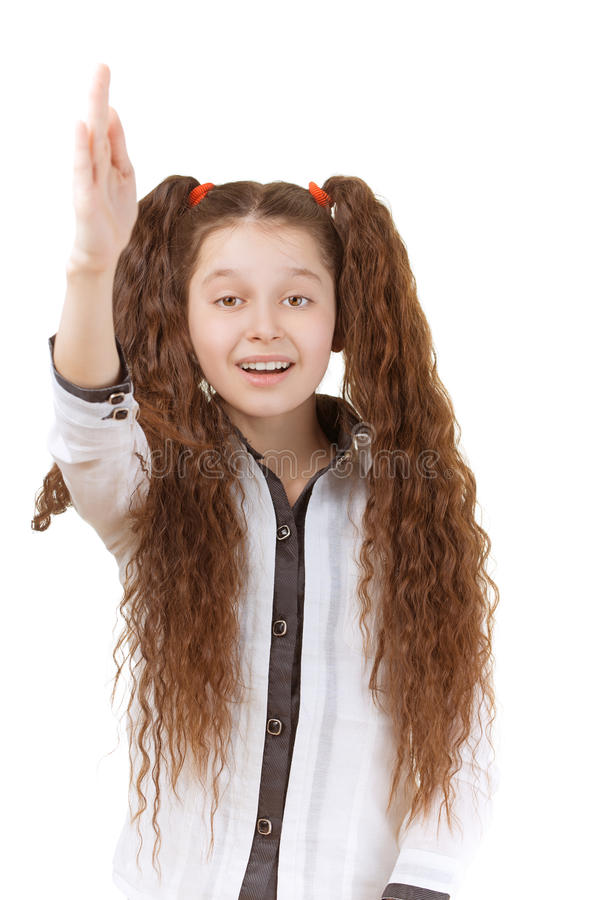 Schoolgirl raises her hand royalty free stock images