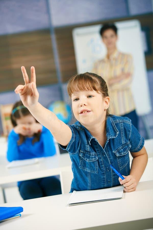 Download Schoolgirl raising hand stock photo. Image of brown, background - 13183566