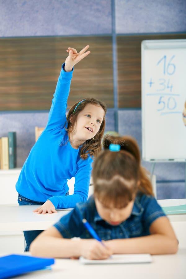 Schoolgirl Raising Hand Royalty Free Stock Photos