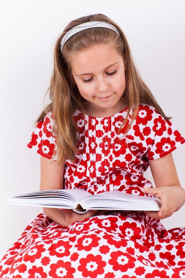 Schoolgirl reading book stock photo