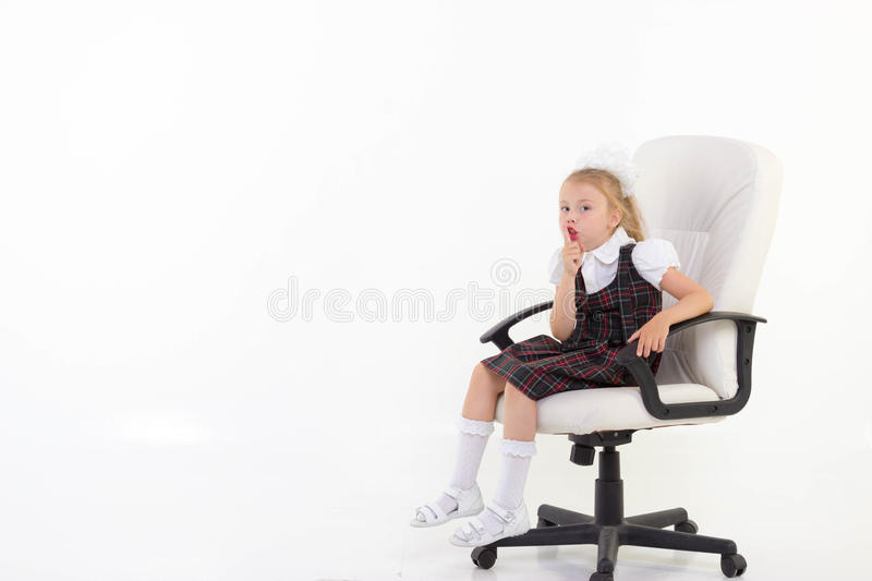 Schoolgirl sit on chair and ask to be quiet. On white background royalty free stock photos