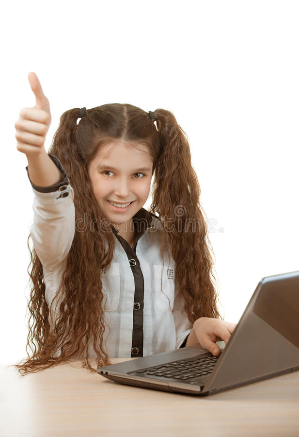 Schoolgirl sitting at laptop royalty free stock photo