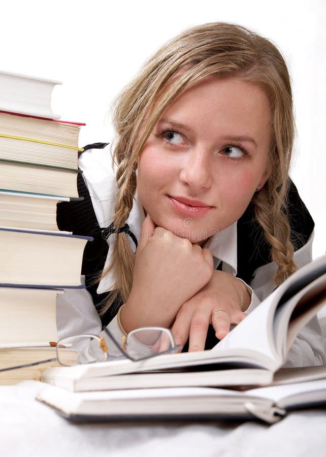 Schoolgirl or student reading stock image