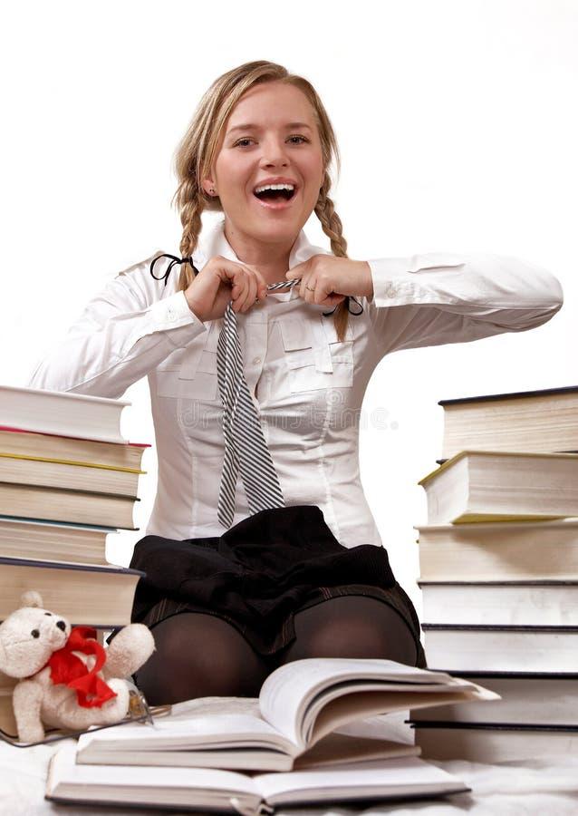Schoolgirl or student taking off tie stock image