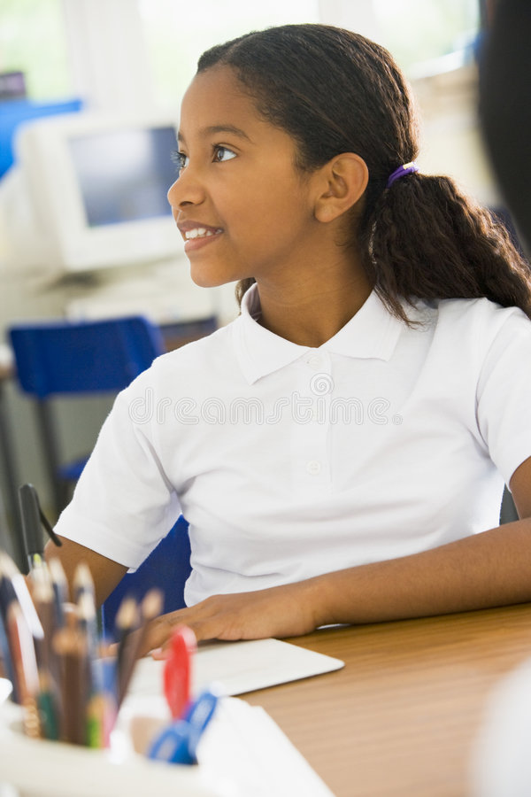 A schoolgirl studying in class stock photos
