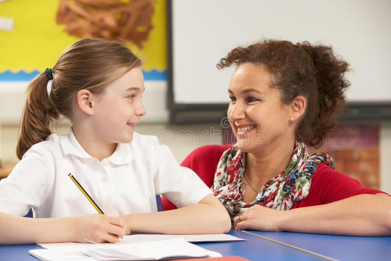 Download Schoolgirl Studying In Classroom With Teacher Stock Photo - Image: 18610962