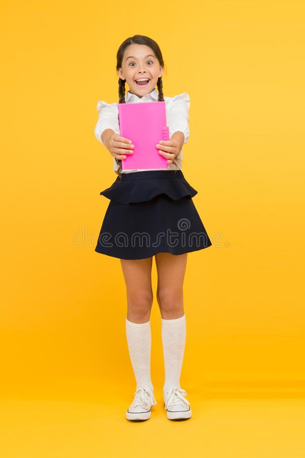 Schoolgirl studying textbook. Kid girl school uniform happy face read book studying. Excited about knowledge. Enjoy stock photos