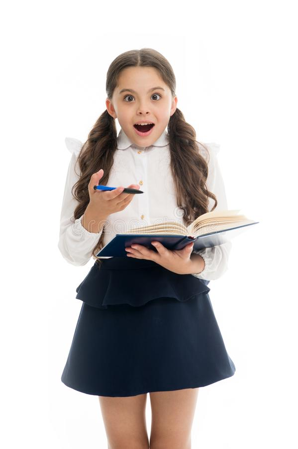 Schoolgirl with surprised look isolated on white. Little child hold book with pen. Back to school. Home schooling royalty free stock images