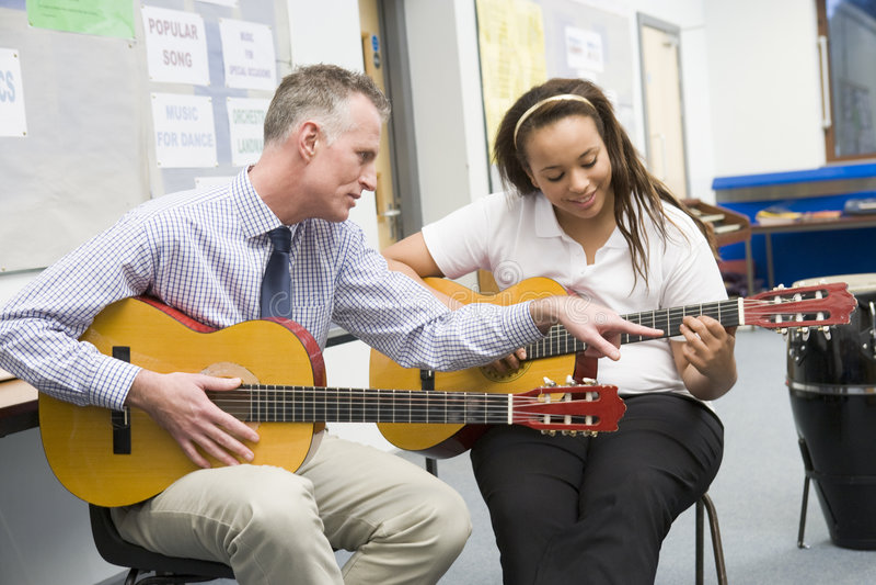 Download Schoolgirl And Teacher Playing Guitar Stock Photo - Image: 6081538
