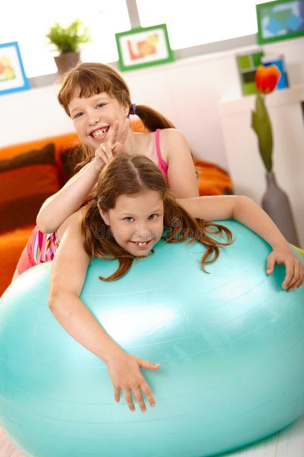Download Schoolgirl Teasing Friend On Gym Ball Stock Image - Image: 18493325