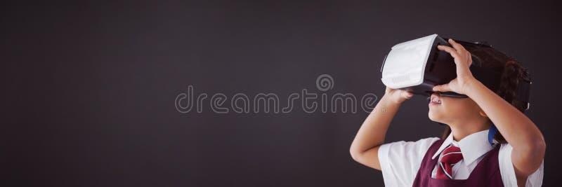 Schoolgirl using virtual reality headset against blackboard. In classroom royalty free illustration
