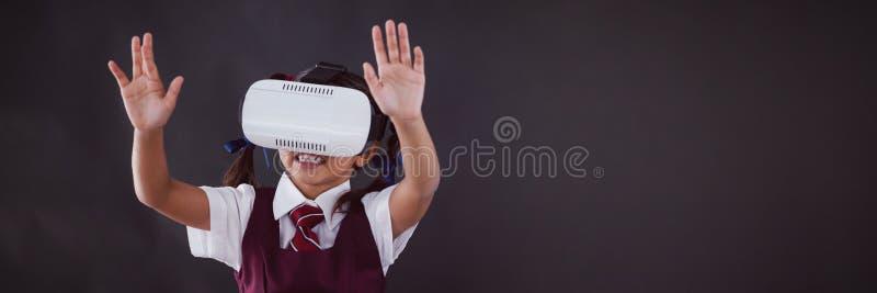 Schoolgirl using virtual reality headset against blackboard stock illustration