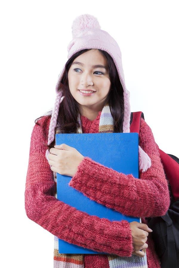 Schoolgirl with winter fashion in studio royalty free stock photo