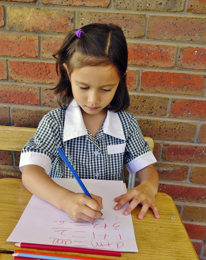 Schoolgirl at Work. royalty free stock image