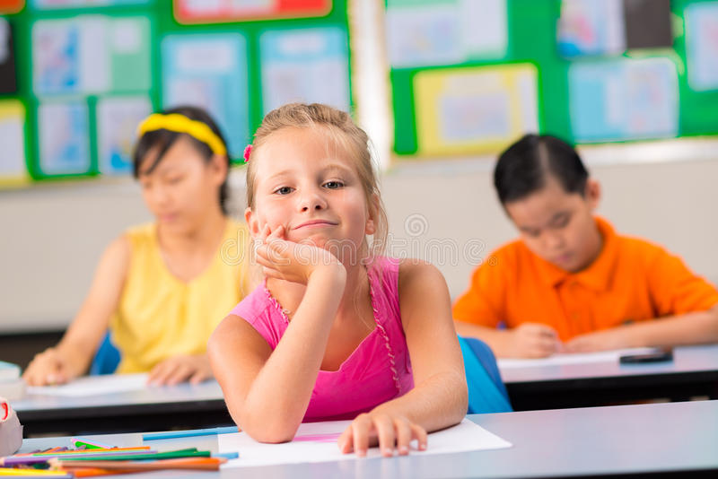 Schoolgirl at workplace royalty free stock photos