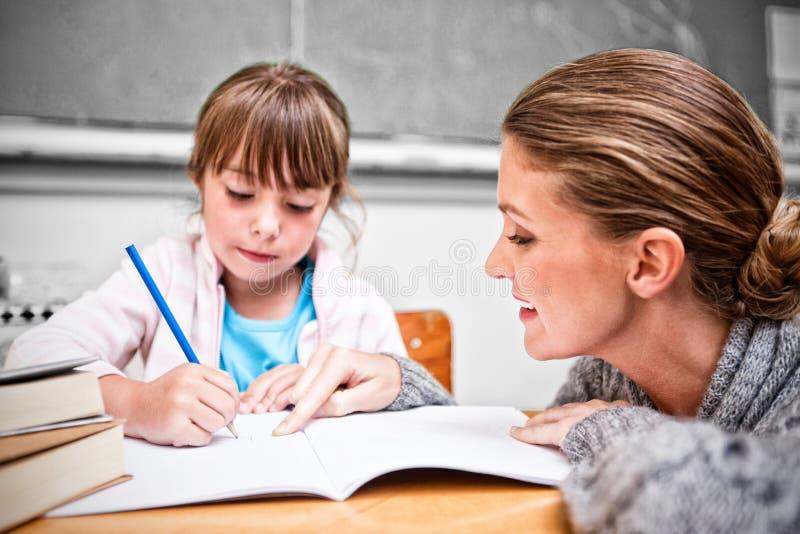 Schoolgirl writing with her teacher in classroom vector illustration
