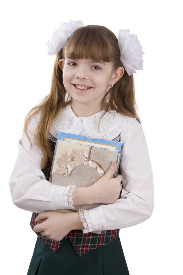 schoolgirllärobok royaltyfri foto