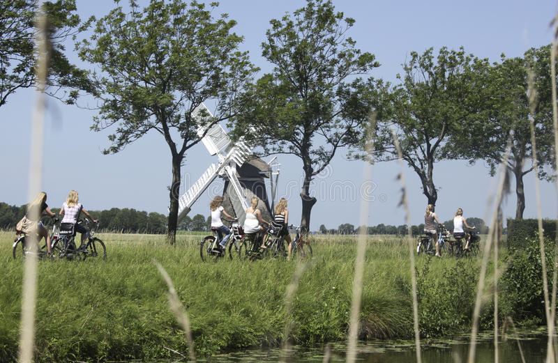 Schoolgirls on a bike in the Netherlands royalty free stock photography