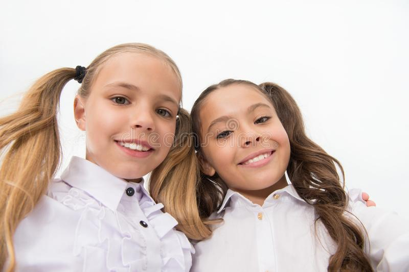 Schoolgirls with cute ponytails hairstyle and brilliant smiles. Best friends excellent pupils. Perfect schoolgirls with royalty free stock images