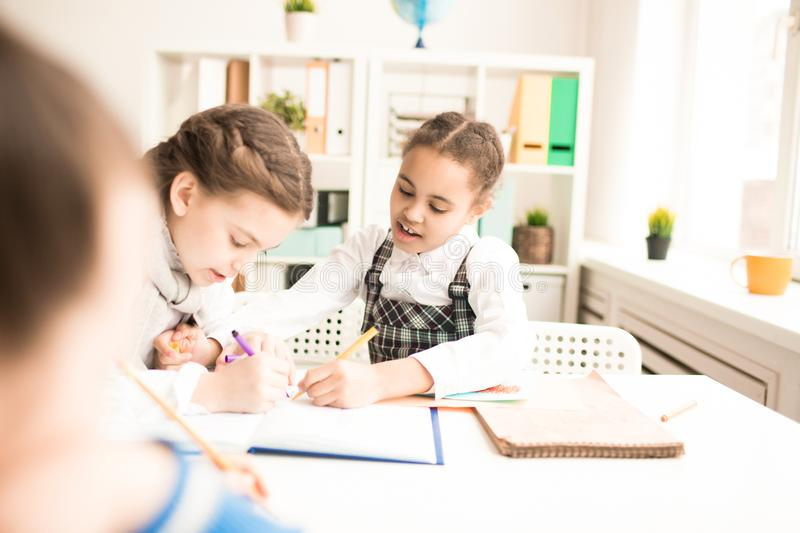 Girls drawing royalty free stock photography