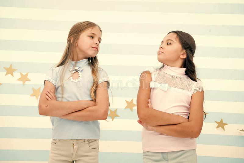 Schoolgirls haughty arrogant with folded arms chest. Best friends become enemies. Friendship relations issues. Girlish. Friendship problem. She definitely stock photo