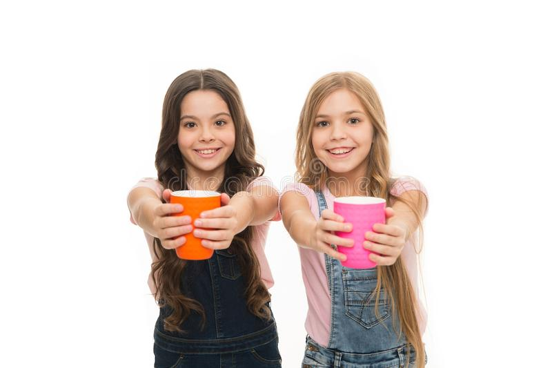 Schoolgirls with mugs having tea break. Relax and recharge. Water balance concept. Enjoying tea together. Sisters or royalty free stock photos