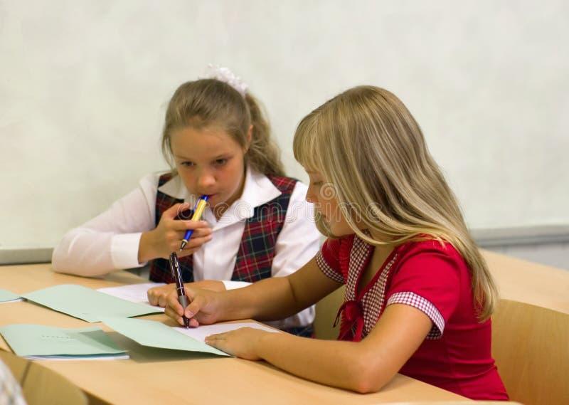 Schoolgirls talking stock image