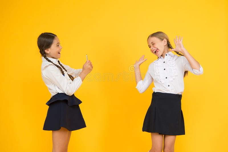 Schoolgirls use smartphone take photo.Life online. Application smartphone. Personal blog. Content making. Social media royalty free stock photo