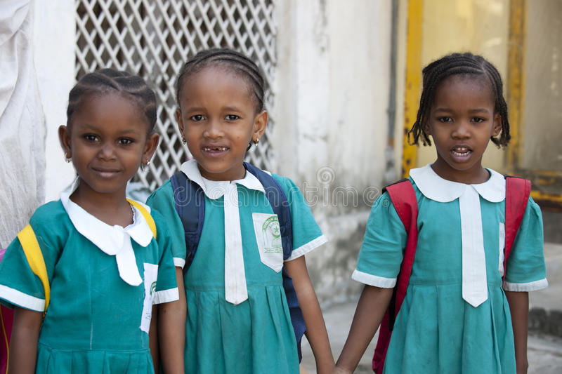 Schoolgirls in Zanzibar. Schoolgirls holding hands in Zanzibar, Africa stock photos