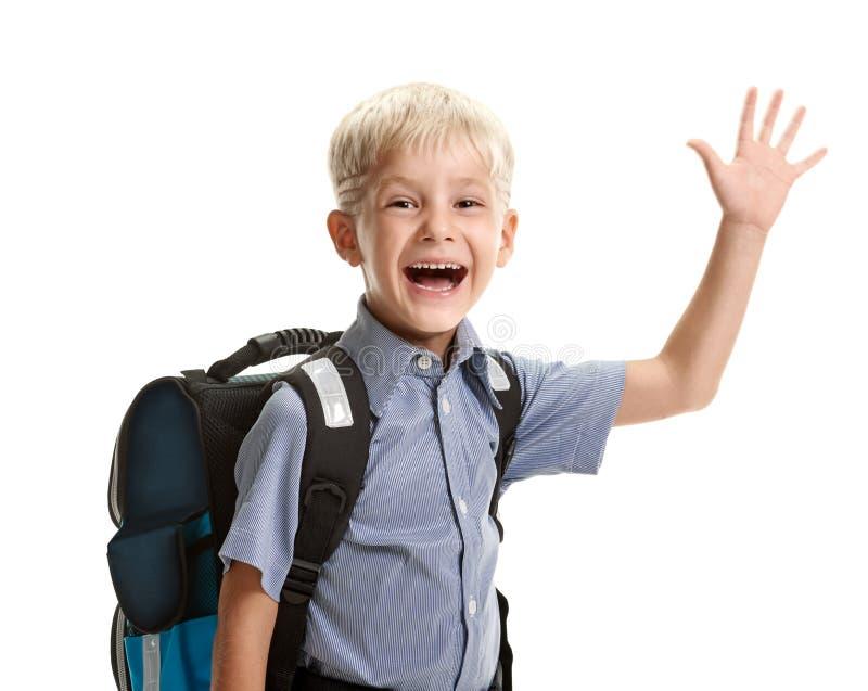 Schooljongen die hello zeggen stock afbeelding