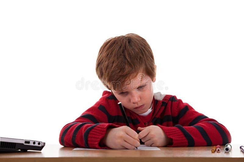 Schooljongen met een droevige uitdrukking stock foto's
