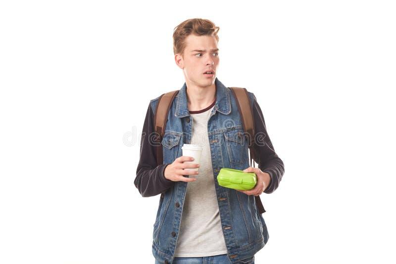 Schooljongen met ontbijt stock afbeeldingen