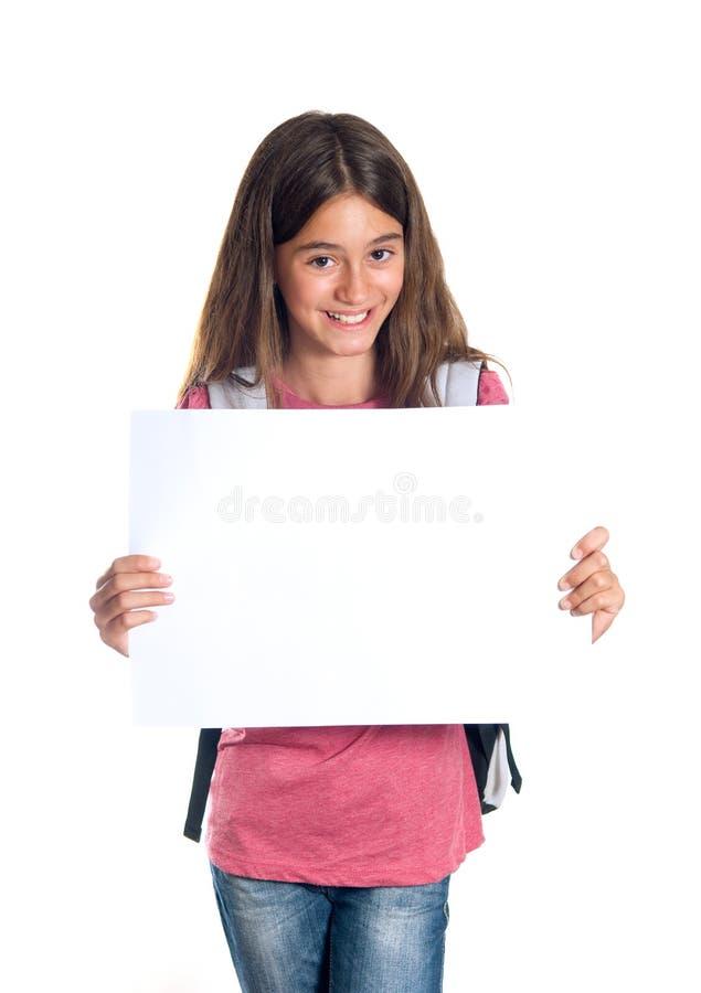 Schoolmeisje dat leeg document houdt royalty-vrije stock foto