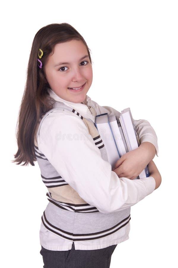 Schoolmeisje die boeken houden stock foto