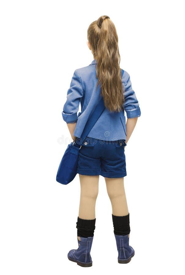 Schoolmeisje in eenvormige achterkantmening Het achtereind van het schoolmeisje, ziet eruit stock foto's