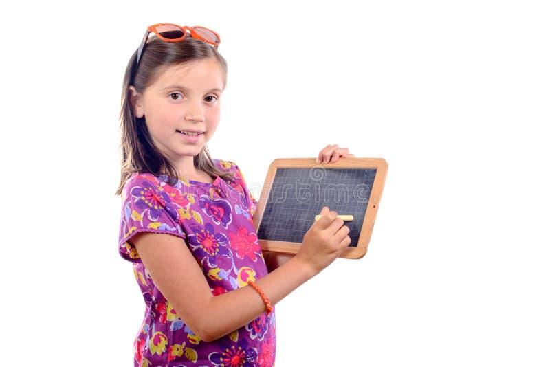 Schoolmeisje met een lei stock afbeeldingen