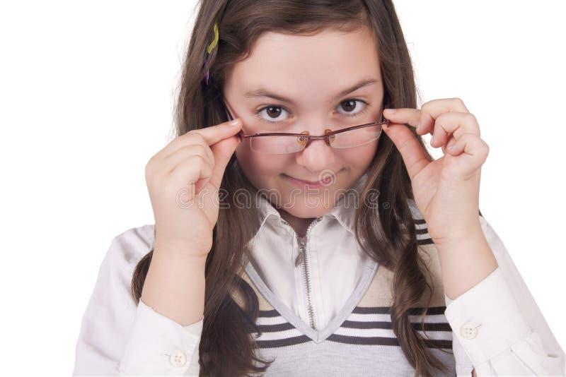 Schoolmeisje met glazen het glimlachen stock foto's