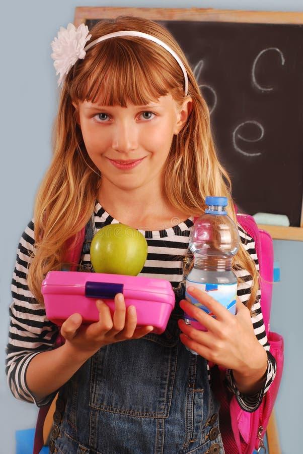 Schoolmeisje met lunchdoos royalty-vrije stock foto's