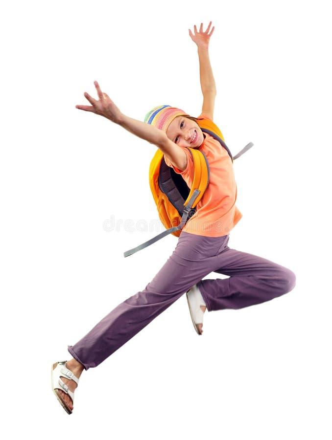 Schoolmeisje met rugzak en GLB-het springen royalty-vrije stock foto