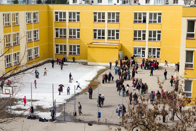 In the schoolyard. Students and some parents in the courtyard of one school from District 1 of Bucharest, Romania.This school was renovated by Program royalty free stock image