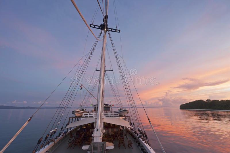 Schooner Sailboat Travel in Raja Ampat. There are around 1,500 uninhabited and remote islands in the Raja Ampat area of eastern Indonesia. Travel by boat is the stock photography