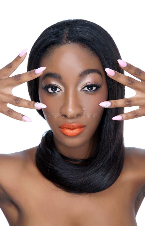 Schoonheid met perfecte haar en spijkers stock afbeeldingen