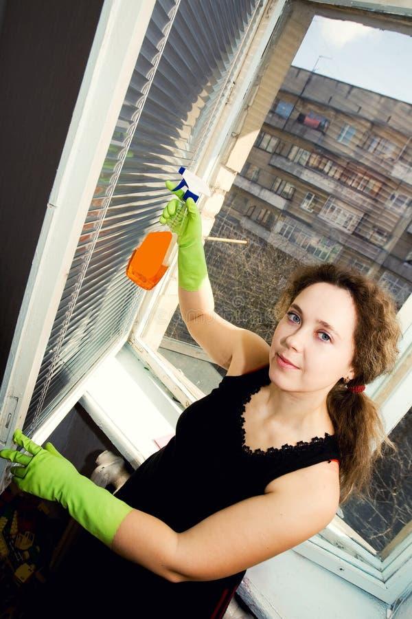 Schoonmakend venster stock foto's